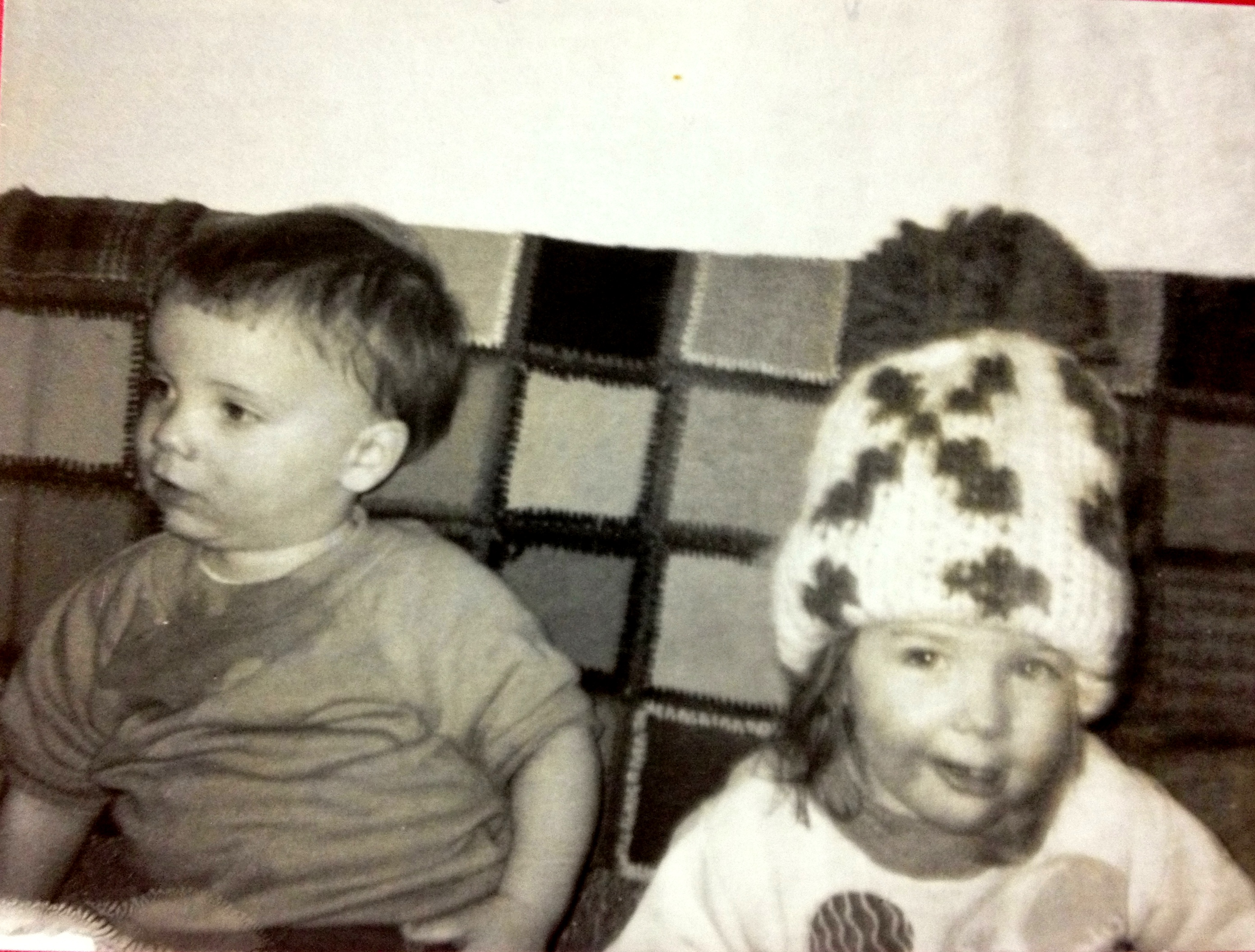 I'm not sure which is worse: Shelly's hat or my drool stains. I do have a pretty content look here, though. Just get me some nachos and find the remote. The game's on. (Cousin Shelly, Spring '69)